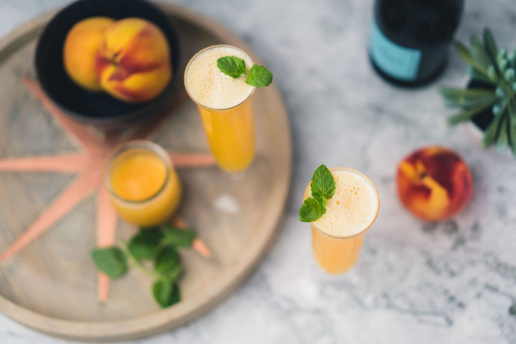 Peach Mimosa Champagne Champagne Glasses Brunch Champagne Flute Citrus Fruit Cocktail Day Drinking Drink Drink Photography Drinking Glass Food Food And Drink Freshness Fruit Garnish Glass Healthy Eating Mimosa Mimosa Tim Mint Leaf - Culinary Orange Orange Color Peach Peach Mimosa Presecco