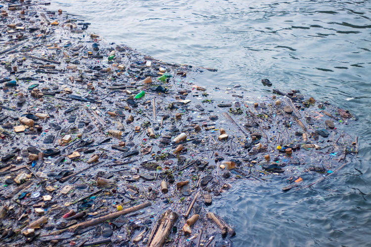 High angle view of garbage floating on sea