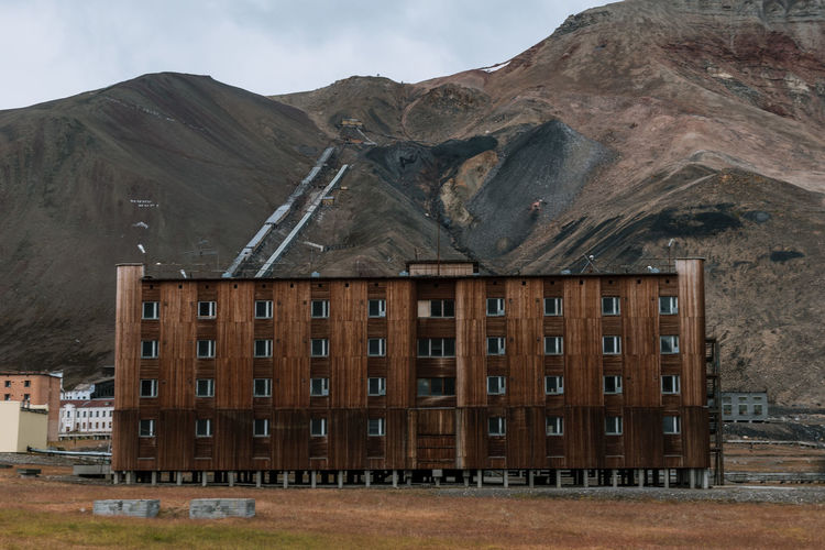 View of building with mountain range in background