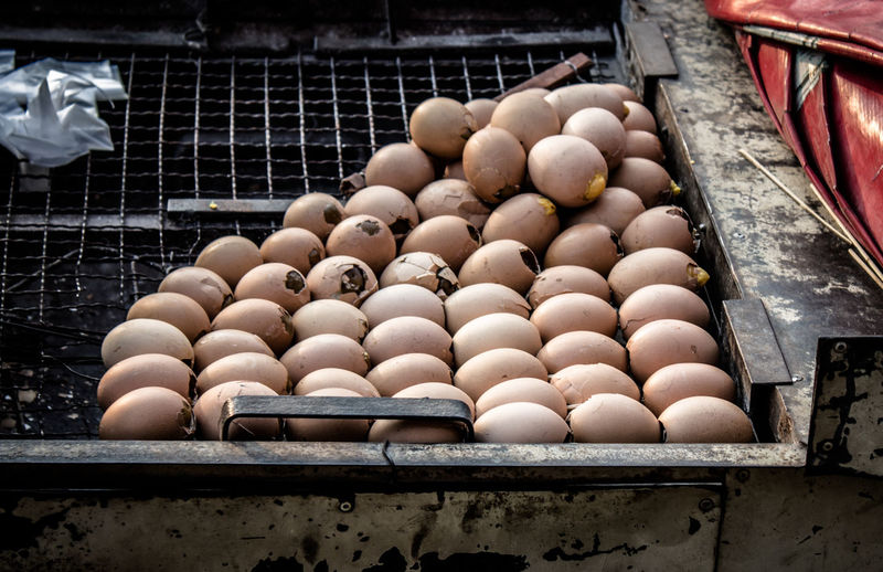 High angle view of eggs on barbecue grill at market