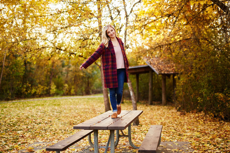 Adult Autumn Beauty In Nature Blond Hair Casual Clothing Change Child Day Forest Full Length Leaf Lifestyles Looking At Camera Nature One Person One Woman Only Only Women Outdoors Park - Man Made Space People Portrait Scarf Smiling Standing Tree