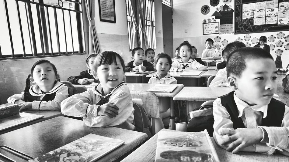 Child Boys Girls Education Learning Childhood Sitting Indoors  Pre-adolescent Child People Friendship Student Togetherness Junior High Day Human Body Part Adult