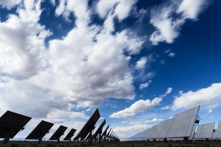 solar panels Sky Cloud - Sky Architecture Built Structure Building Exterior Low Angle View Nature Building Day No People City Outdoors Blue High Section Modern Office Building Exterior Industry Office Sunlight Construction Industry Solar Panels