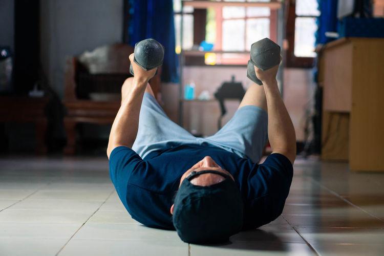 Full length of man lying on floor