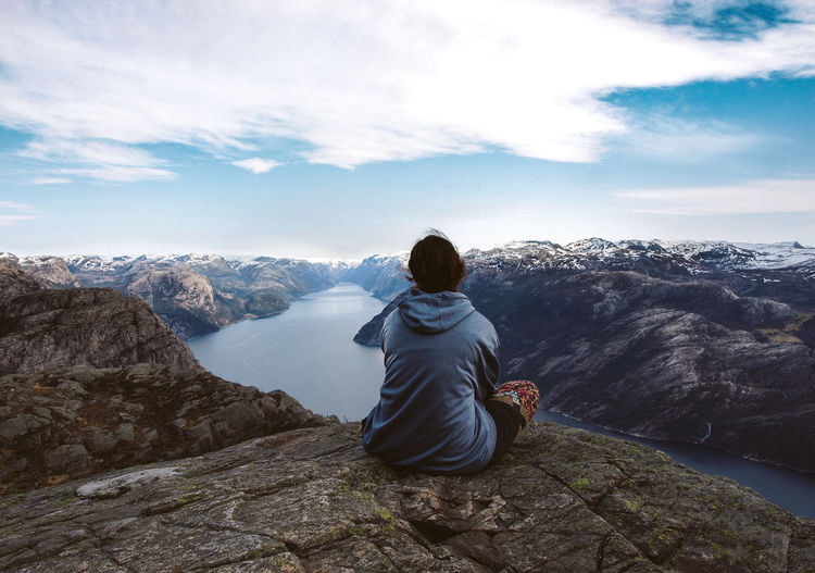 Adult Adventure Beauty In Nature Cloud - Sky Contemplation Courage Day Hiking Landscape Meditation Mountain Mountain Range Nature Norway One Person Outdoors People Preikestolen Real People Rear View Scenics Sky Tranquil Scene Tranquility Young Adult Women Around The World