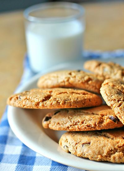 Close-up of chocolate cookies with milk on table