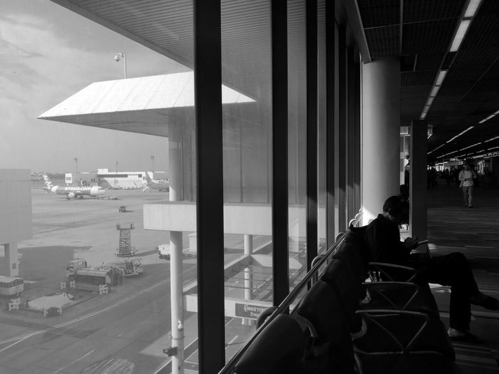 Man sitting on chair in airport