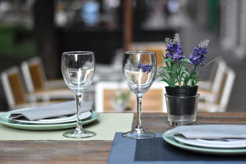 Empty wineglasses on table in restaurant