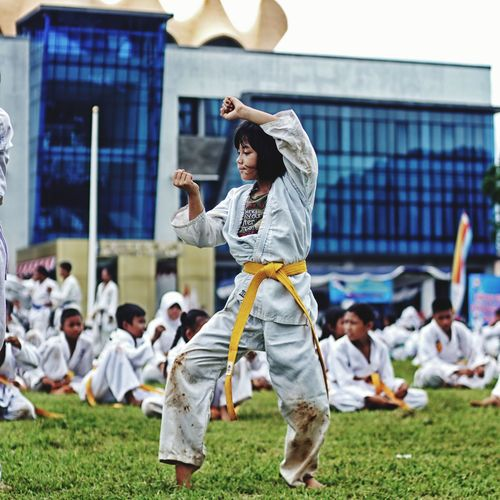 Girl practicing karate on field