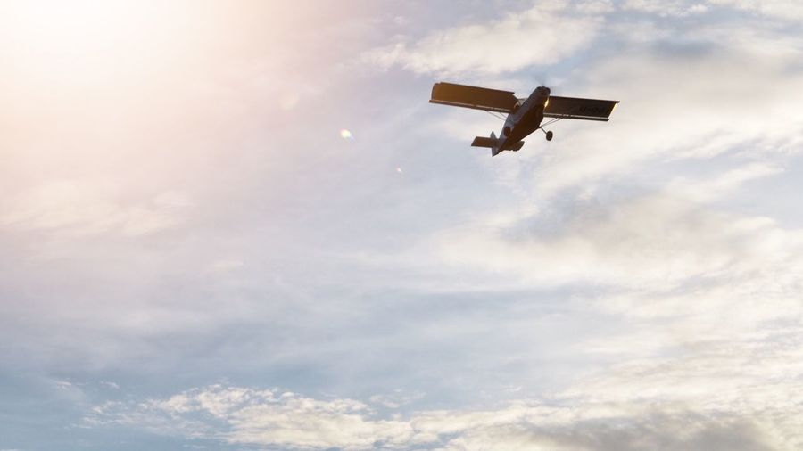 Agricultural air plane is flying in twilight sky Cloud - Sky Sky Flying Low Angle View Air Vehicle Transportation Mode Of Transportation No People Mid-air Nature on the move Airplane Helicopter Travel Outdoors Day Emergency Services Occupation Motion Control Rescue Worker