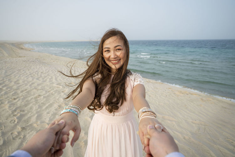 Girl Smiling and Holding Both Hand in Beach Beach Sea Land Smiling Water Happiness Emotion Portrait Looking At Camera Long Hair Horizon Over Water Leisure Activity Women Horizon Hairstyle Young Adult People Sky Adult Teeth Beautiful Woman Hair Positive Emotion Outdoors Love Relationship Vacations Travel Ijas Muhammed Photography