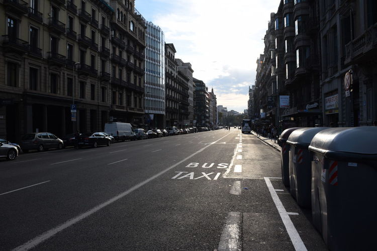 Barcelona's avenue at sunset Barcelona Urban Lifestyle Architecture Building Exterior Car City City Street Dividing Line Mode Of Transportation Motor Vehicle No People Outdoors Road Sign Street Symbol The Way Forward Transportation
