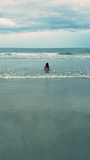 Sitting in the Surf. Beach One Person Real People Sky Wave Waves Ocean Girl Water Sea Tranquility Hilton Head Island Hilton Head Island, SC Hilton Head SC Kids Sand Cloud - Sky Relax Meditation Travel Tourism