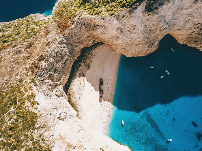 Leftover Photo Tropical DJI Mavic Pro Dji Dronephotography Drone  Aerial View Island Holiday Travel Destinations Travel Shipwreck Beach Shipwreck Zakynthos Greece Water Sea Nature High Angle View Sunlight Land Day Beach Sand Outdoors Shadow Blue Beauty In Nature Rock Lifestyles Summer Road Tripping The Creative - 2018 EyeEm Awards