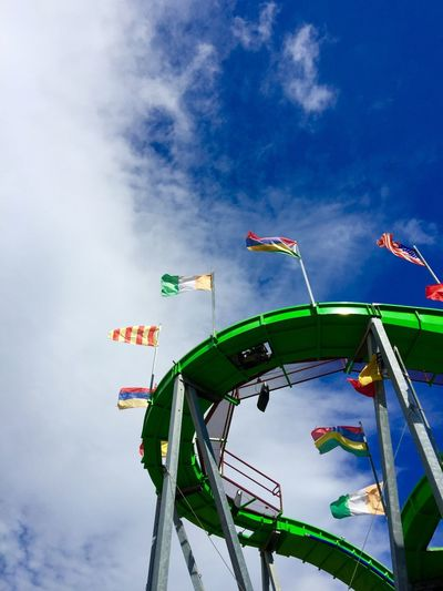 Low Angle View Of Flags On Rollercoaster Track