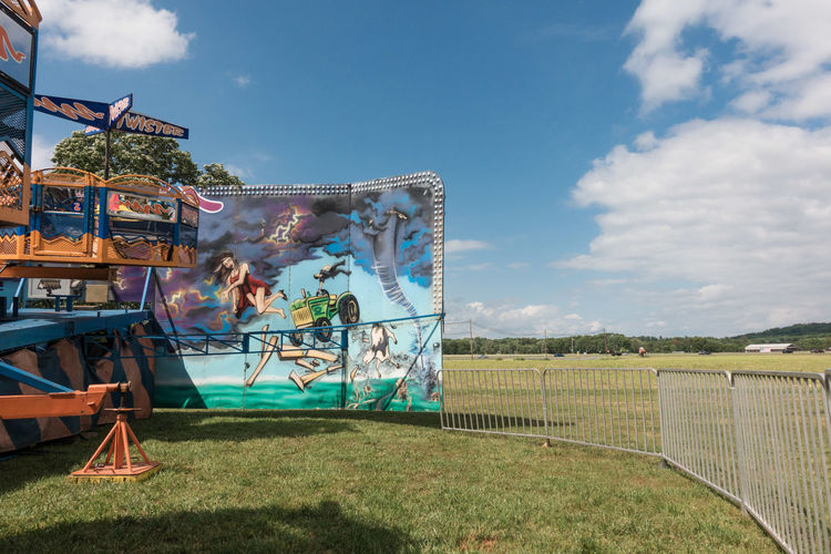 Carnival Day Field Grass Mural Nature No People Outdoors Ride Sky