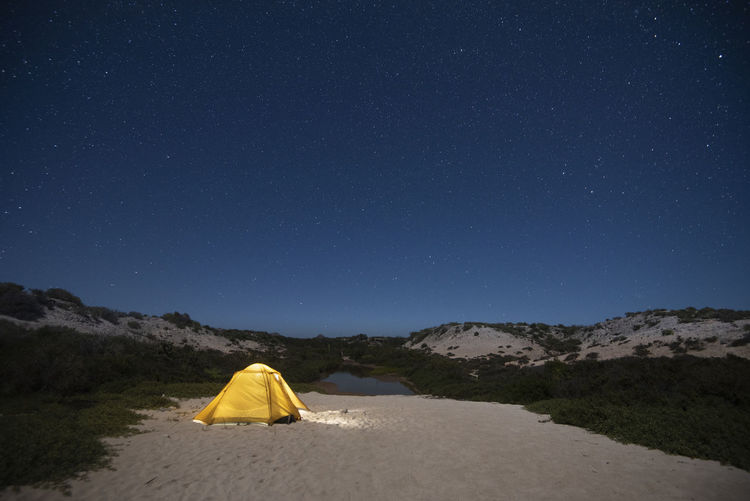 Scenic view of landscape against clear sky at night