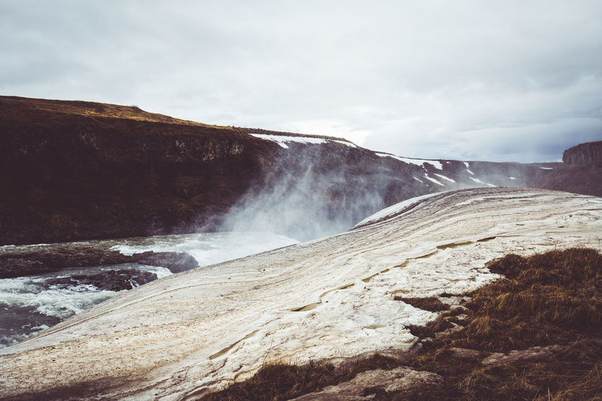 """Days of travel: 6 - Gullfoss, the """"Golden Falls"""" Iceland Nature Nature Photography Beauty In Nature Cloud - Sky Day Environment Flowing Flowing Water Hot Spring Landscape Long Exposure Nature Nature_collection No People Non-urban Scene Outdoors Power In Nature Rock Rock - Object Scenics - Nature Sky Water Waterfall Waterfalls The Great Outdoors - 2018 EyeEm Awards"""