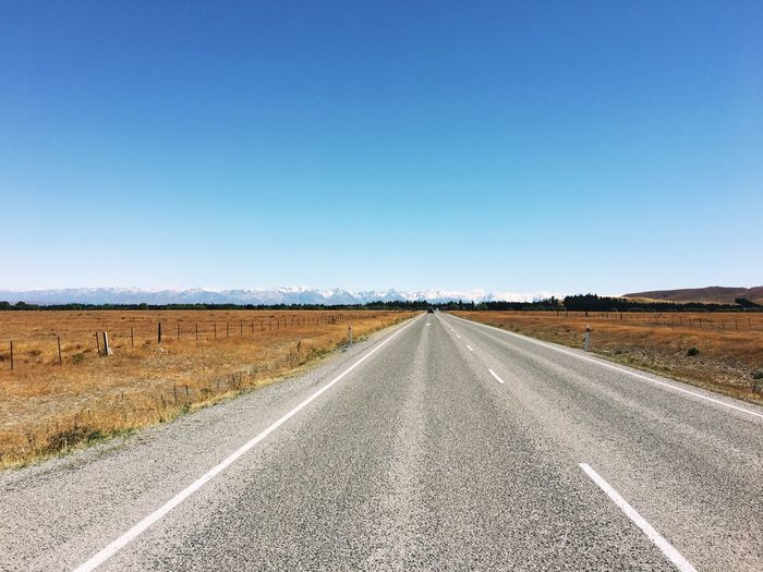 Clear Sky Blue Road On The Road On The Way Landscape The Way Forward Nature No People Day Scenics Empty Road Tranquil Scene Non-urban Scene Outdoors Road Trip Southern Alps New Zealand Nature Tranquility Snow Mountain