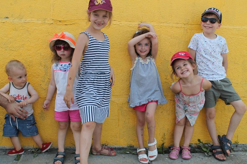 Holiday Kids Paint The Town Yellow Casual Clothing Child Childhood Children Only Enjoyment Friendship Full Length Fun Happiness Kidsphotography Leisure Activity Looking At Camera Outdoors People Portrait Posing Smiling Standing Summer Togetherness Vacations Yellow