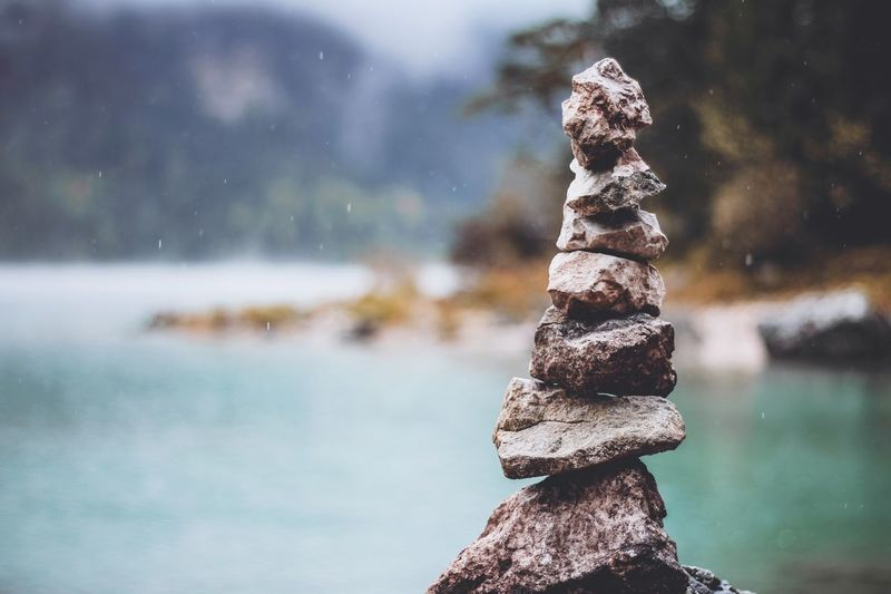 Close-up of stone stack on rock by sea