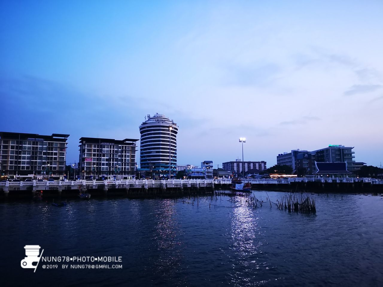 architecture, building exterior, built structure, water, sky, city, waterfront, building, no people, nature, river, transportation, cloud - sky, reflection, nautical vessel, travel destinations, outdoors, dusk, office building exterior, modern, skyscraper, passenger craft