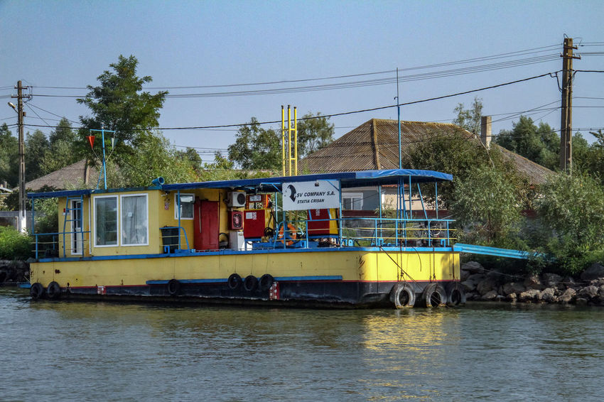 Danube Delta Danube Architecture Building Exterior Built Structure Cable Clear Sky Day Electricity  Electricity Pylon Mode Of Transport Nature Nautical Vessel No People Outdoors River Sky Transportation Tree Water Waterfront Waterway To Sulina