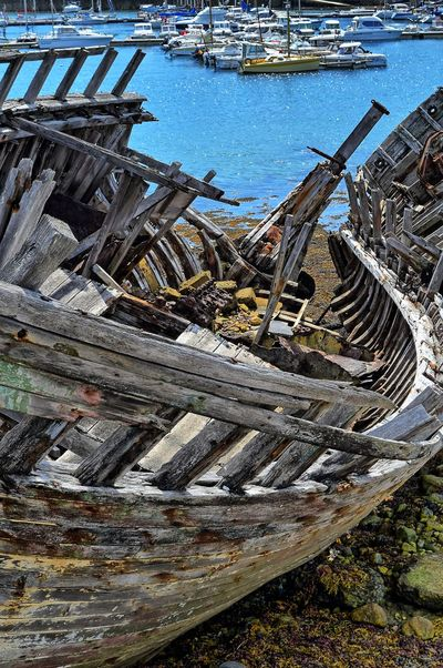 Ship recycling at Camaret-Sur-Mer Shipyardlife Wood Weathered Wood Wrecked Ship Wrecked Ship Wrecked Boat. Water Ship Salvage Nautical Vessel Cloud - Sky Brittany Camaret-sur-Mer Recycling Ship Breakers Ship Run Aground No People Day Outdoors High Angle View Wood - Material Nature Transportation Sky