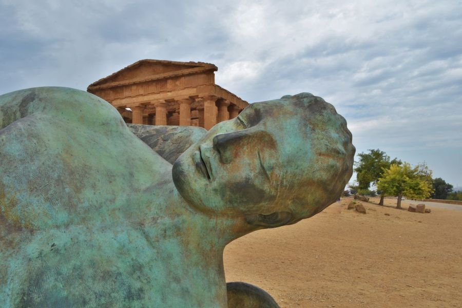 Agrigento Ancient Art Buddha Carving - Craft Product Cloud Cloud - Sky Cloudy Craft Creativity Day Famous Place History Monument Old Sculpture Sicilia Sky Statue Stone Material Temple - Building The Past Tourism Travel Destinations Valle Dei Templi