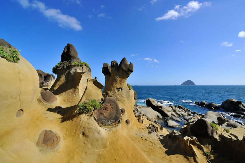 Geological landscape of blue sky, Taiwan Keelung Hepingdao Park, strange rock shapes. Rock Taiwan Beauty In Nature Blue Coastal Day Geology Horizon Over Water Keelung Landscape Nature No People Outdoors Park Peace Island Rock - Object Rock Formation Scenics Sea Seaside Sky Sunlight Tranquil Scene Tranquility Water