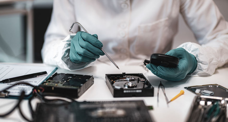 Close-up of man working on hard disk drive