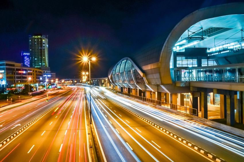 in town Illuminated Architecture City Night Long Exposure Building Exterior Built Structure Light Trail Transportation Road No People Bridge - Man Made Structure Street Light