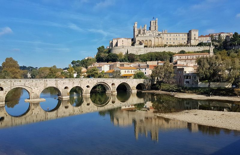 Reflection Nature Water Landscape Built Structure No People Bridge - Man Made Structure Outdoors Travel Destinations City Tranquility Growth River Sky Architecture Forest Occitanie Scenics beziers Building Exterior sacral