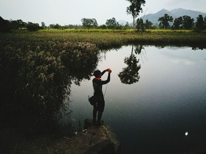 Fishing Nature One Person Water Full Length Men Beauty In Nature Outdoors One Man Only Adults Only Adult Sky Tree Day Only Men People Young Adult