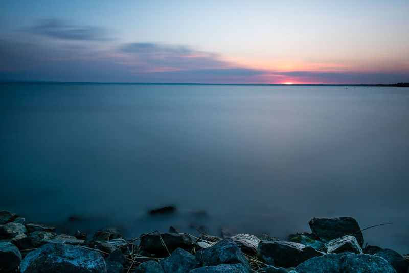 Beauty In Nature Dawn Day Horizon Over Water Lakeshore Landscape Nature No People Outdoors Rock Rocks Rocks And Water Scenics Sky Sun Sunrise Tranquil Scene Tranquility Water