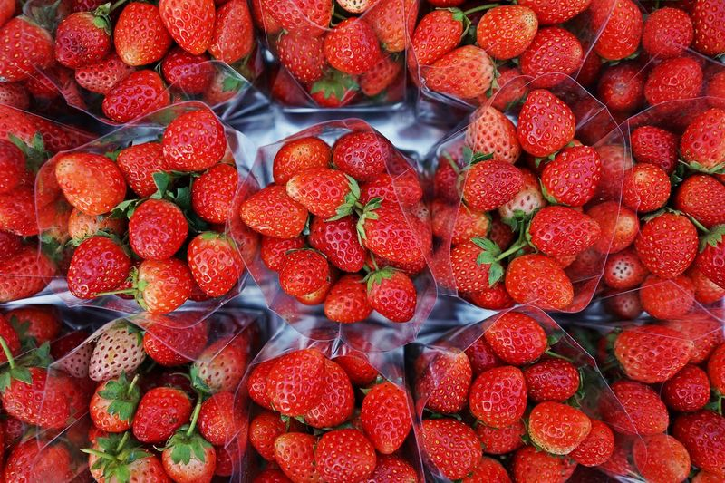 Strawberry fruit on market, colorful fruit enrich with vitamin