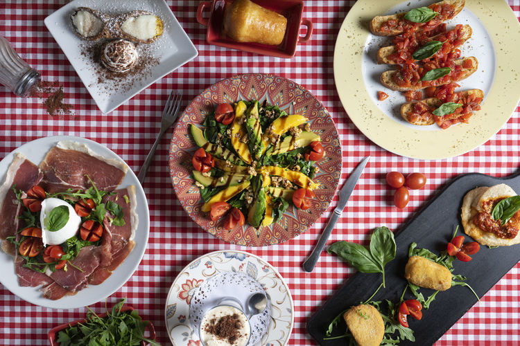 Panorama of italian food. various salad, skewer and dessert dishes.