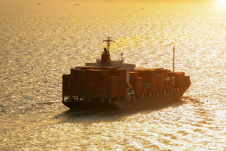 Shipping  Outdoors Built Structure Ship Sunlight Travel No People Business Architecture Sunset Freight Transportation Mode Of Transportation Sky Nature Transportation Waterfront Nautical Vessel Sea Water
