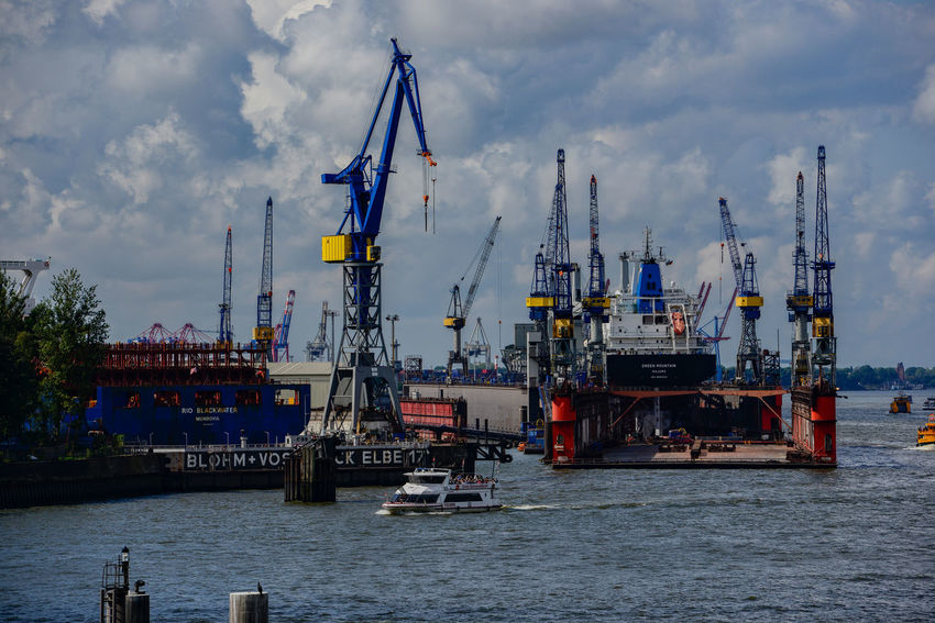 Hamburg skyline view from the waterfront Charges Container Container Port Elbe Philharmonic Hall Hamburg Harbor Industry Landing Bridges Saint Pauli Terminal Burchardkai Traffic Transport Bridge Concert Hall  Crane Elbe Harbor Town Port Port Of Hamburg  Ship Shipping  Terminal Trade Water