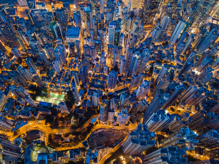 Aerial view of Hong Kong Downtown. Financial district and business centers in smart city, technology concept. Top view of skyscraper and high-rise buildings at night. Architecture Business City Cityscape Downtown Drone  Hong Kong Residential  Top Aerial View Apartments Architecture Blue Building Exterior Buildings Built Structure City Cityscape Fuel And Power Generation High Angle View High Rise Building Illuminated Industrial Equipment Industry Metropolis Mode Of Transportation Motion Nature Night No People Outdoors Pollution Road Skyscapers Street Transportation