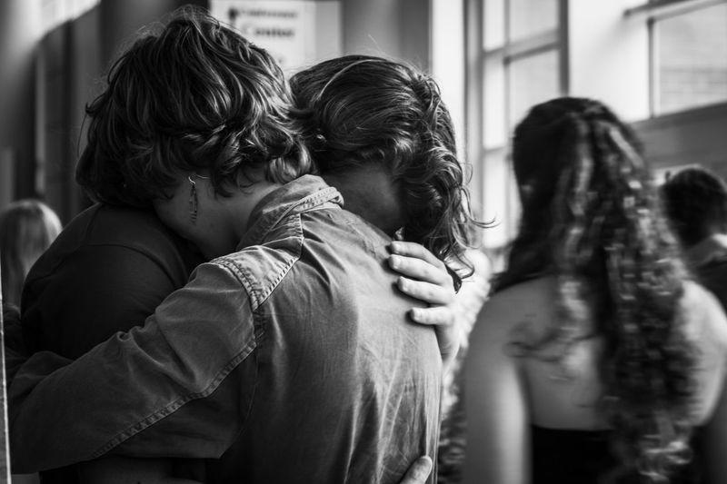 Close-Up Of Siblings Hugging