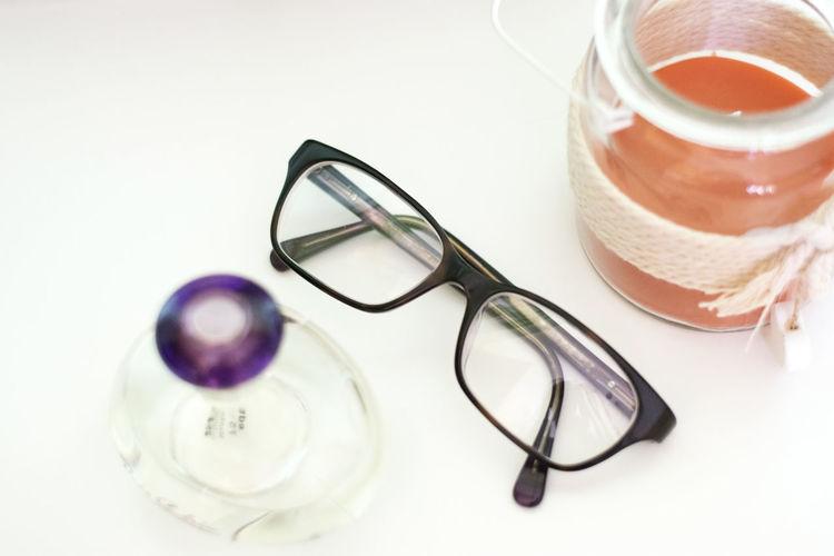 High angle view of eyeglasses on glass table