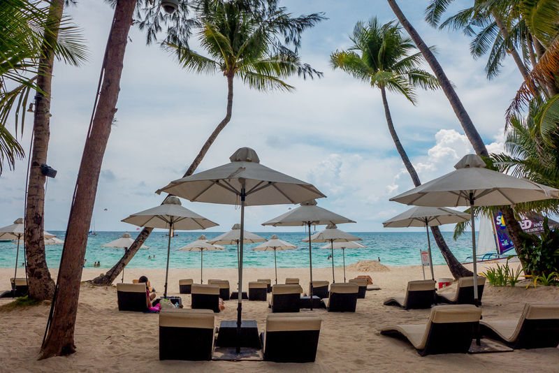Absence Beach Beach Umbrella Beauty In Nature Boracay Philippines Day Empty Horizon Over Water Idyllic Nature Outdoors Palm Tree Parasol Relaxation Scenics Sea Shore Sky Summer Tourism Tranquil Scene Tranquility Tree Vacations Water