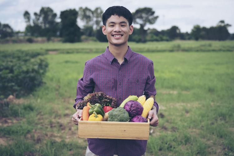 Portrait of mature man in field