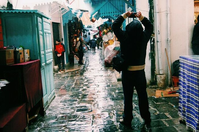 The Eyeem photographer. Tunis Tunisia Medina Rainy Day Eyeem Community Street One Person Outdoors Wet Men Adult Adults Only People City Day Water Extreme Weather One Man Only Only Men Shades Of Winter Focus On The Story