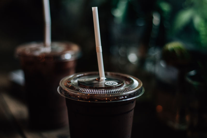Close-up of drink in disposable glasses