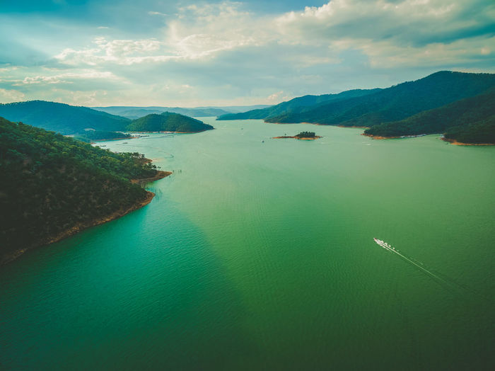 Aerial view of lonely boat sailing on beautiful lake among hills at sunset Australia Australian Landscape Beautiful Breathtaking Drone  Panorama Panoramic Scenic Aerial View Beauty In Nature Day Drone Photography Eildon High Angle View Lake Landscape Mountain Nature Nautical Vessel No People Outdoors Scenics Sea Sky Sunset Tranquil Scene Tranquility Water