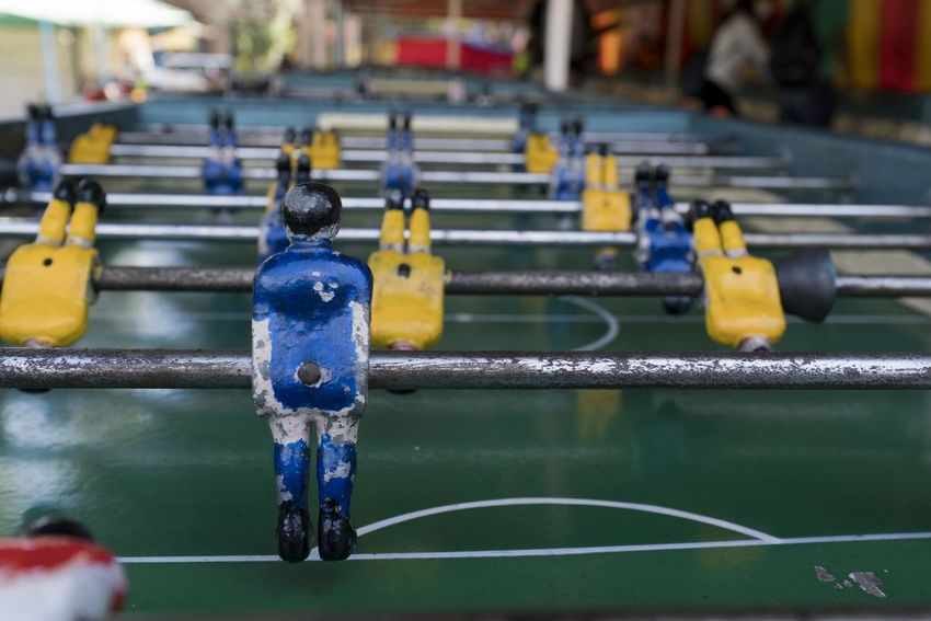 Close up of a soccer table installed in a public square. Focus On Foreground Representation Water Day Human Representation Sport No People Soccer Metal Nature Close-up Team Sport Blue Male Likeness Connection Outdoors Figurine  Competition