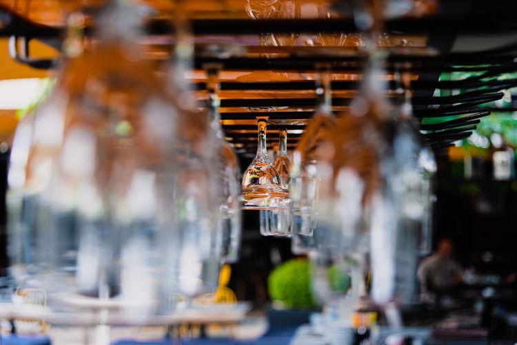Upside down image of lanterns hanging in restaurant