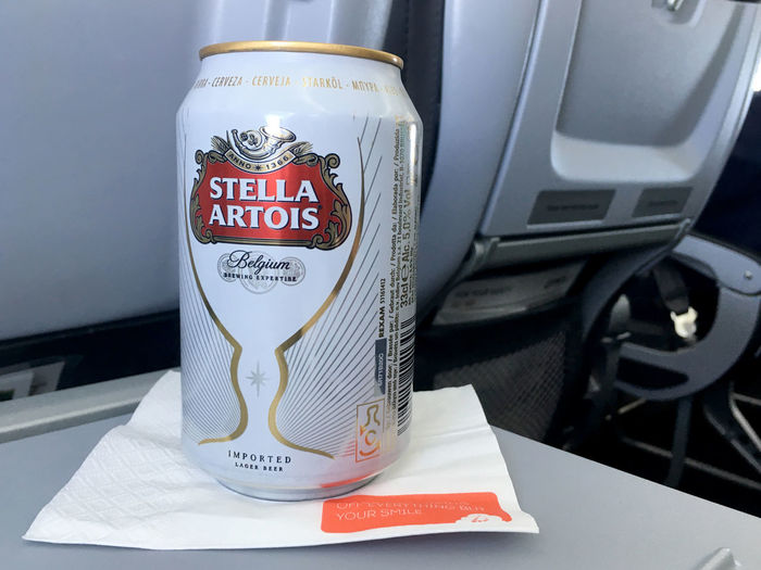 Brussels, Belgium - 15 August 2017: Aluminum can of Stella Artois on a white napkin sitting on folding seat tray in economy class during a Brussels Airlines flight. Can of Belgium beer Stella Artois. AirPlane ✈ Flights Stella Artois Stella ❤ Airplane Airplanes Brussels Airlines Brussels Belgium Flight Flight ✈ Stella Stellaartois